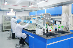 Laboratory experiment. Modern design biochemical laboratory  with scientists doing experiment. It's the Research and Development Center of a biotechnology Stock Images