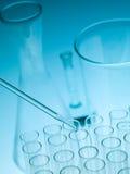 Laboratory experiments glassware on blue gradient background Stock Photo