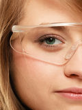 Laboratory. Face of chemist woman in goggles glasses Royalty Free Stock Photography
