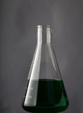 Laboratory Flask with liquid chemicals Stock Photos