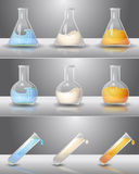 Laboratory flasks with liquids inside Stock Images