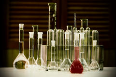 Laboratory flasks. On the table Stock Photography