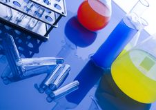 Laboratory glass. Es over blue background Stock Images