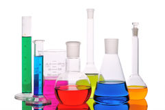 Laboratory glass. With color liquid on a white background Stock Photography