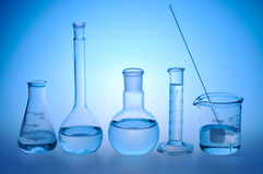 Laboratory glass. On a blue background Stock Photography