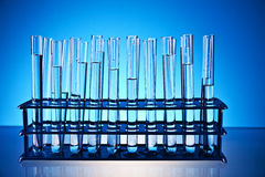 Laboratory glass. Ware on the blue background Royalty Free Stock Photography