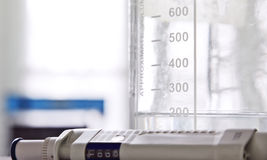 Laboratory glass and pipette Stock Image
