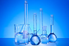 Laboratory glassware. On the blue background Stock Photos