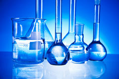 Laboratory glassware. On the blue background Stock Images