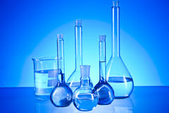 Laboratory glassware. On the blue background Royalty Free Stock Photos