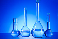 Laboratory glassware. On the blue background Stock Photo