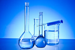 Laboratory glassware. On the blue background Royalty Free Stock Image