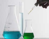 Laboratory glassware and arm Stock Photography