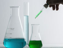 Laboratory glassware and arm Royalty Free Stock Images