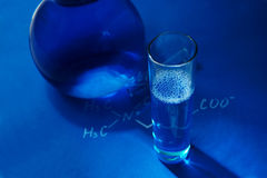 Laboratory glassware on blue background. Chemistry  - concept photo Stock Photo