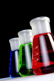 Laboratory Glassware - Breakers. 3 colors  chemicals in laboratory glassware in a row - Close up Stock Photos