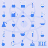 Laboratory glassware. Laboratory, chemical flasks, bulbs, atom on a blue background Stock Photos