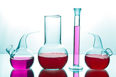Laboratory glassware with chemicals Stock Images