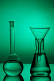 Laboratory glassware on color background. On the table Stock Photography