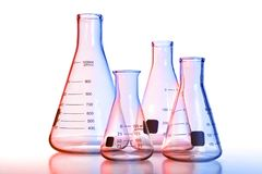 Laboratory Glassware With Colored Reflections. Over white background royalty free stock image