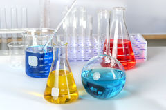 Laboratory Glassware with Colored Solutions Royalty Free Stock Photos