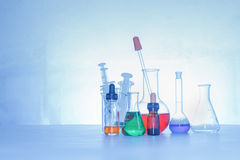 Laboratory glassware containing chemical liquid, science researc Stock Image
