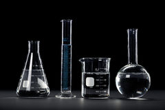 Laboratory Glassware on Dark Background Royalty Free Stock Images