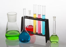 Laboratory glassware filled with various coloured liquids. Royalty Free Stock Photos