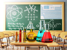 Laboratory glassware with formula on blackdesk in the school che Stock Photos