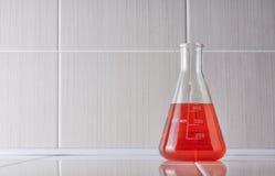 Laboratory glassware and glass ceramic desk. Royalty Free Stock Photo