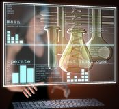Laboratory glassware on hologram Stock Photography