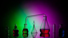 Laboratory glassware with liquids Stock Images