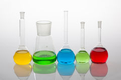 Laboratory glassware with liquids of different colors Stock Photo