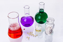 Laboratory glassware with liquids of different col Stock Photos