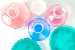 Laboratory glassware with liquids of different colors Stock Image