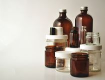 Laboratory glassware, medical and cosmetic jars and bottles Royalty Free Stock Photos