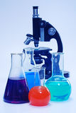 Laboratory glassware and microscope Royalty Free Stock Photo