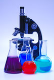 Laboratory glassware and microscope Stock Photos