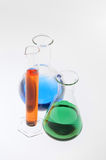 Laboratory glassware with multicolored liquid. Flask, cylinder and beaker with multicolored liquid Stock Images