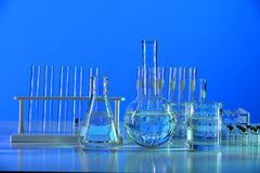 Laboratory Glassware on Reflective Table Royalty Free Stock Photos