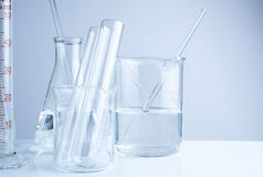 Laboratory glassware on table, Symbolic of science research. Royalty Free Stock Photos