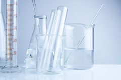 Laboratory glassware on table, Symbolic of science research. Royalty Free Stock Image