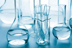 Laboratory glassware toned blue Stock Photos
