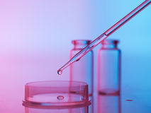 Laboratory glassware with tranparent liquid in pipette Royalty Free Stock Images