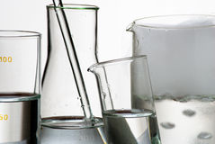 Laboratory glassware and vapors over liquid Royalty Free Stock Images