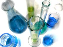 Laboratory glassware on white. Chemistry laboratory glassware empty and with fluid on white background Stock Images