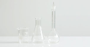Laboratory glassware on white Royalty Free Stock Image