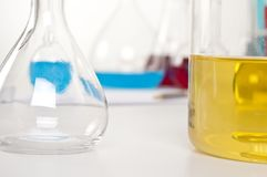 Laboratory items, flask with yellow liquid Royalty Free Stock Photography