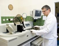 Laboratory man and machine Stock Photography