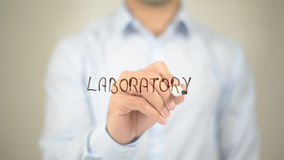 Laboratory, man writing on transparent screen. High quality Royalty Free Stock Photos